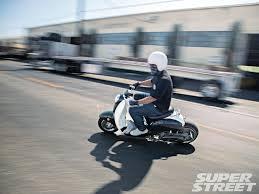 Sstp 1212 01 2006 2007 Honda Ruckus Metropolitan Cover 03 Riding