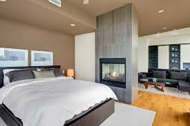 modern master bedroom with l shaped couch built in bookshelf in