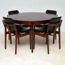 Danish Rosewood Dining Chairs By Arne Vodder Table