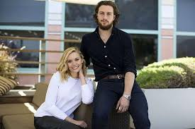 Cast Members Elizabeth Olsen And Aaron Taylor Johnson Pose For A Portrait While Promoting The Avengers Age Of Ultron In Burbank California April 11