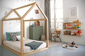 A house framed floor bed in a Montessori Inspired Toddler Room