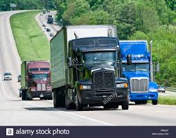 Three Big Trucks On The Interstate Highway Stock Photo: 89257355 - Alamy Medical Waste From Truck Crash Spills Across I10 In Arizona Inrstate 18 Wheeler Group Board Pinterest Semi Trucks Inrstate Truck Trailer Repair Llc 517 Photos 12 Reviews Drive Act Would Let 18yearolds Drive Commercial Inrstateguide 278 New Jersey York Moving Home Shiny American Volvo Transporting Mobile Battery Of Allentown Pennsylvania Kenworth T300 Battery A Steady Mix Cars And Suvs Roll Down An Big Rig Jackknifed On I40 After Volving 2 Abc11com Best Shop Clare Mi Quality Tire Batteries Nascar Hauler Transporter Steady Flow Semis Lead Image Photo Free Trial Bigstock