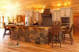log home by golden eagle log homes island kitchen stone wood