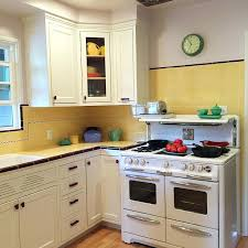 1940s Kitchen Cabinets Gorgeous Remodel Featuring Yellow Tile With Maroon Trim Wood
