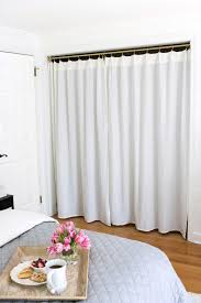 Floor To Ceiling Tension Pole Room Divider by Replacing Bi Fold Closet Doors With Curtains Our Closet Makeover