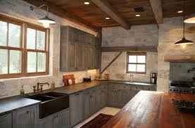 industrial barn lights shine in a rustic industrial kitchen