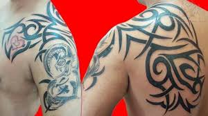 Tribal Tattoo On Bicep And Back Shoulder