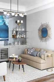 living room with gray built in bar and mirrored wall
