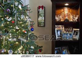 Picture Of Frames In Shelf By Decorated Christmas Tree