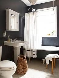 Chandelier Over Bathroom Sink by Nice Bathroom With Black Walls And Chandelier Over Black Mat And
