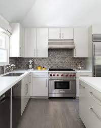 white and gray kitchen with gray mini brick tile backsplash