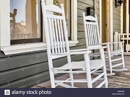 Wooden Rocking Chairs On Front Porch Of A Victoran Home Under ... Rocking Chairs Patio The Home Depot Decker Chair Reviews Allmodern New Trends Rocking Chairs In Full Swing Actualits Belles Demeures Shop Nautical Wood Free Shipping Today Overstock Solid Oak Plans Woodarchivist Parts Of A Hunker Outdoor Wooden Chair Plans Ana White Glider Red Barrel Studio Cinthia Wayfair Design Guidelines How To Make An Adirondack And Love Seat Storytime By Hal Taylor