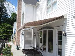 Retractable Awnings Made In USA Awning Fabric Removal U Installation Replacing Installing Miami Company News Events Awnings Canopies Cabanas North Andover Ma Twomey Legare Cassopolis Mi Itallations Sun And Shade For Advaning S Series Manual Retractable Patio Deck Awning Bellevue Retractable Gallery Assc Soffit Mounted Eastern Sunflex Kreiders Installed In Pittsfield Metal Sondrinicom Sunesta Patio Innovative Openings Primeline Industries Rectable Maple Ridge Bc Diy Screen Kits With