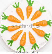 Delicious and sweet home made carrot cake with marzipan carrot figurines decoration close up details