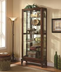 curio cabinet with light house decorations
