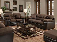 Brown Couch Decor Living Room by Laminated Walnut Wooden Floor And Dark Brown Sofas With Green Wall