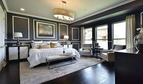 Art Deco Master Bedroom With Dark Color Scheme And Wood Floors