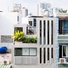 Narrow Windows Allow Daylight Into Terrazzo Covered House In Ho Chi Minh City
