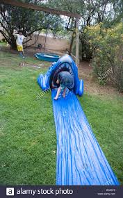 Child Climbing Into A Shark Shaped Slip And Slide, At Home In ... More Accurate Names For The Slip N Slide Huffpost N Kicker Ramp Fun Youtube Triyaecom Huge Backyard Various Design Inspiration Shaving Cream And Lehigh Valley Family Just Shy Of A Y Pool Turned Slip Slide Backyard Racing With Giant 2010 Hd Free Images Villa Vacation Amusement Park Swimming 25 Unique Ideas On Pinterest In My Kids Cided To Set Up Rebrncom Crazy Backyard Slip Slide