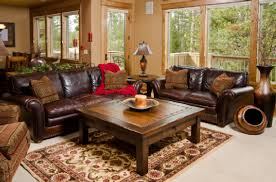 Living Room Cream Wall Dark Brown Leather Sofa Red Blanket Wooden Coffee Table Desk