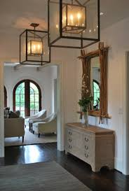 New traditional a clean architectural white foyer with dark wood