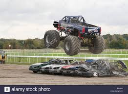 100 Truck Jumping Monster Truck Jumping Crushed Cars In A Race Stock Photo 20314260