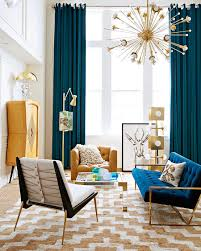In Gallery Blue Drapes Offer A Dramatic Backdrop To The Living Space