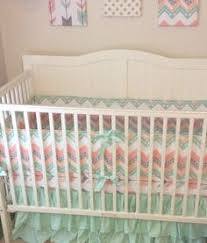 mint peach and gray arrows ruffled crib bedding for a baby