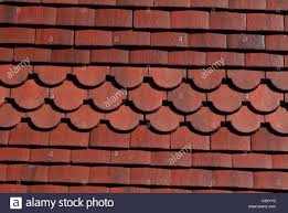backgrounds and scalloped clay roof tiles stock