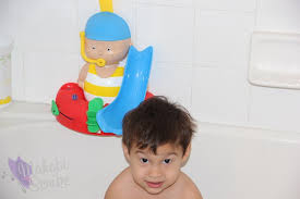 pretending at bath time with the newest caillou tub toy makobi