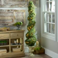 Spiral Pre Lit Christmas Trees warm up every corner of your home for the holidays with greenery