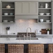 This Is The Most Adorable Farmhouse Kitchen Olive Gray Shelving With Wicker Chairs All Pop Against Light Bright Backsplash And Countertops