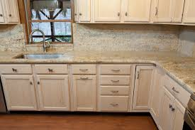 white cabinets with granite that has more brown in it home is