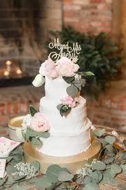 White Wedding Cake Made By The Bride On Gold Stand Fresh Peony Flowers And Eucalyptus Silver