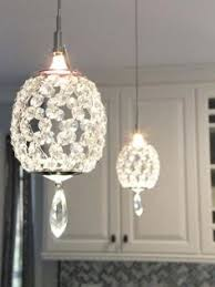 pendant lights a peninsula bring a touch of glam to