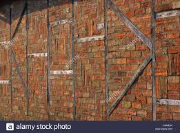 Old Barn Wall In Bedfordshire With Bricks And Exposed Wooden Beams ... Mortenson Cstruction Incporates 100yearold Barn Into New Old Wall Of Wooden Sheds Stock Image Image Backdrop 36177723 Barnwood Wall Decor Iron Blog Wood Farm Old Weathered Background Stock Cracked Red Paint On An Photo Royalty Free Fragment Of Beaufitul Barn From The Begning 20th Vine Climbing 812513 Johnson Restoration And Cversion Horizontal Red Board 427079443 Architects Paper Wallpaper 1 470423