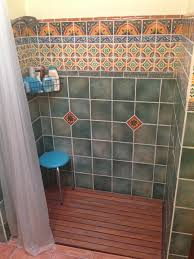 the branded towels and the mexican style tile in the shower