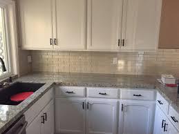 Kitchen Backsplash Pictures With Oak Cabinets by Swiss Coffee Over Oak Cabinets Champagne Glass Mosaic Backsplash