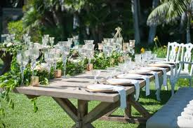 Garden Wedding Reception With Rustic Wood Table Greenery White Flowers Glass Candleholders
