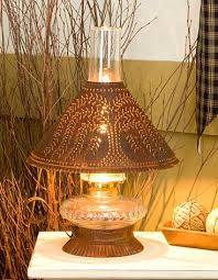 Punched Tin Lamp Shades Uk by Rustic Tin Cupid Oil Lamp With Willow Design Buy At The Weathered