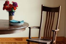 Dining Room Chairs With Arms Arm Chair Table And Flowers In Vase