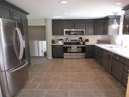traditional brown cabinet gray kitchen island beige tile