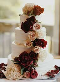 Four Tier Ruffled Cake With Burgundy Roses Wedding
