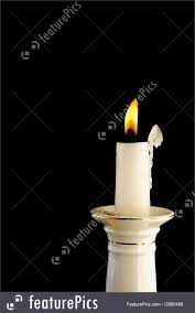 House Decor White burning candle in candlestick in the dark background