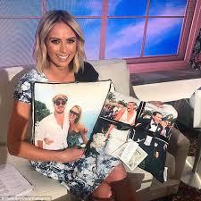 Sylvia Jeffreys receives a wedding themed cushion from fan