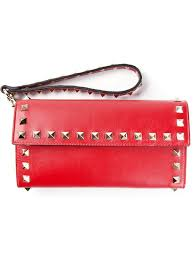 valentino rockstud wristlet wallet in red lyst