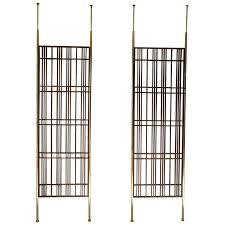 is it a room divider pole l display shelf tension rod ideas