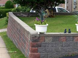How To Build A Retaining Wall The Mortarless Way - Incoming ... Brick Garden Wall Designs Short Retaing Ideas Landscape For Download Backyard Design Do You Need A Building Timber Howtos Diy Question About Relandscaping My Backyard Building Retaing Fire Pit On Hillside With Walls Above And Below 25 Trending Rock Wall Ideas Pinterest Natural Cheap Landscaping A Modular Block Rhapes Sloping Also Back Palm Trees Grow Easily In Out Sunny Tiered Projects Yard Landscaping Sloped