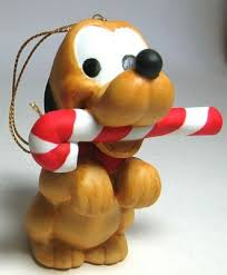 Plutos Christmas Tree Ornament baby pluto with candy cane in his mouth ornament from our