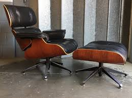Eames Style Lounge Chair And Ottoman In Black Leather   Vinterior Eames Style Lounge Chair Thebricinfo Eames Style Lounge Chair And Ottoman Black Leather Palisander Ottomanwhite Worldmorndesigncom Charles Specialist Hans Wegner Replica The Baltic Post And Brown Walnut Afliving Eames 100 Aniline Herman Miller Century Reproduction 2 Plycraft Style Lounge Chair Ottoman